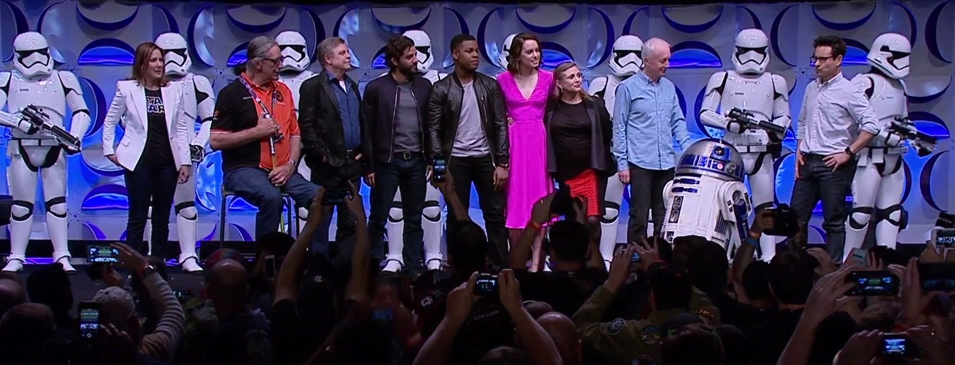 (From l to r) Kathleen Kennedy, Peter Mayhew, Mark Hamill, Oscar Isaac, John Boyega, Daisy Ridley, Carrie FIsher, Anthony Daniels and J.J. Abrams about to unleash the second trailer for Episode VII, at Star Wars Celebration 2015.