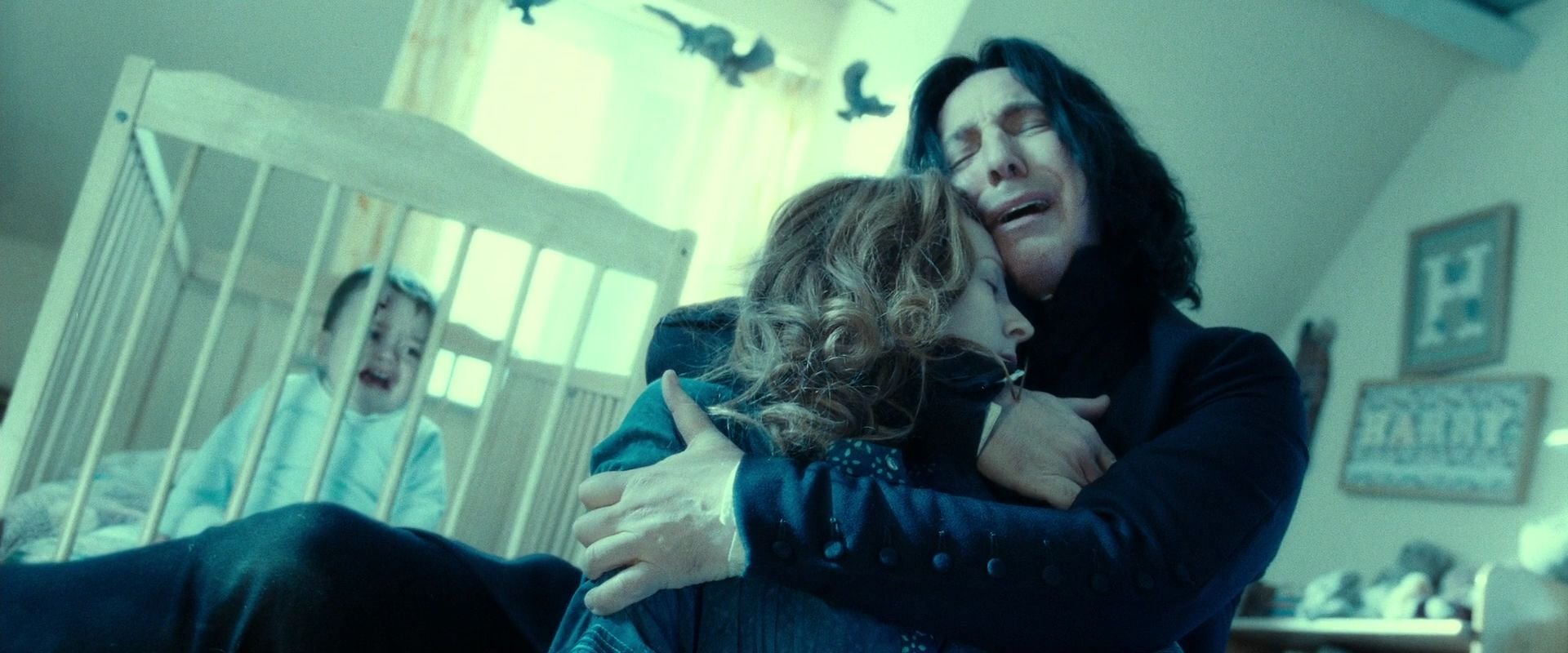 Toby Papworth as Baby Harry, Geraldine Somerville as Lilly Potter and Alan Rickman as Professor Severus Snape, HARRY POTTER AND THE DEATHLY HALLOWS PART 2 (2011). Warner Bros.