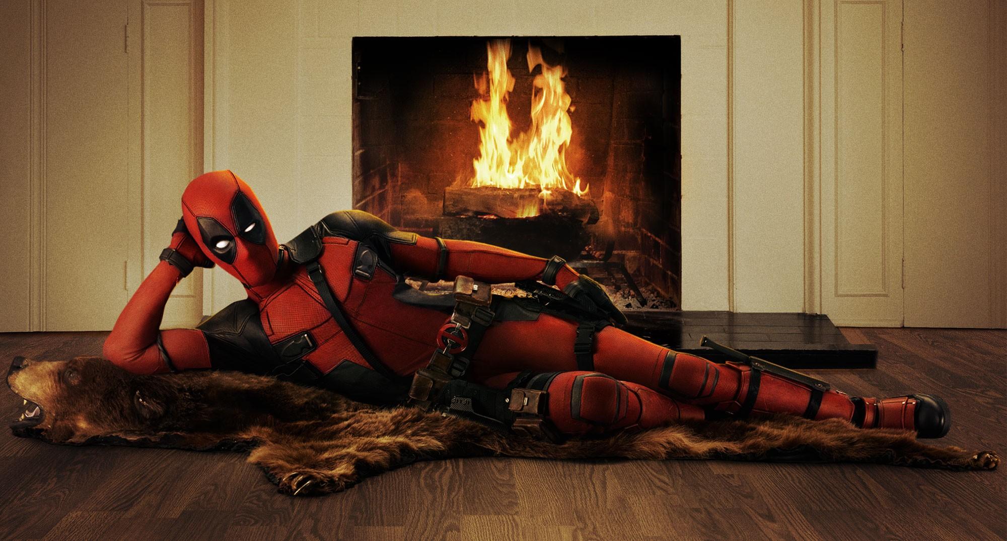 DEADPOOL relaxing by the fireside. (20th Century Fox)