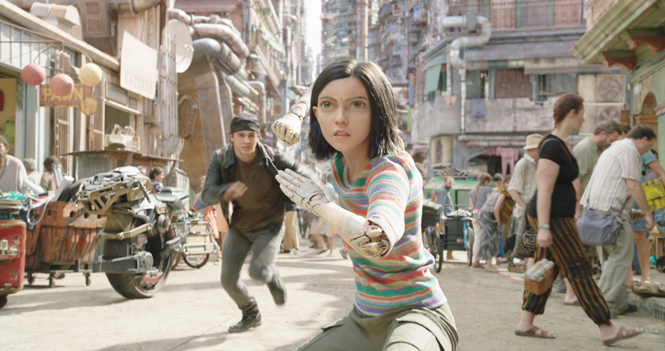 Keean Johnson (left) and Rosa Salazar (centre) in Twentieth Century Fox's ALITA: BATTLE ANGEL. Photo Credit: Courtesy Twentieth Century Fox.
